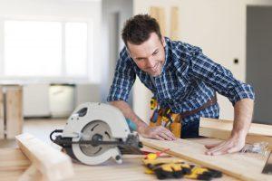 Smiling carpenter checking result of his work
