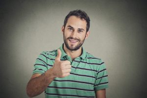 Happy man giving thumbs up sign.